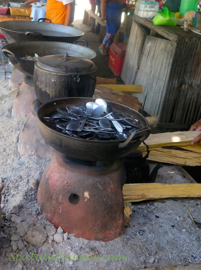 Clay stoves at the seaside food stall, Malatapay Market