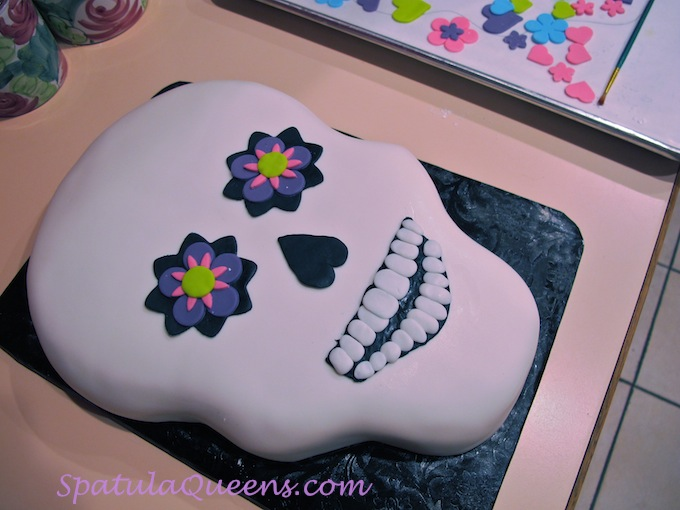Decorating the skull cake