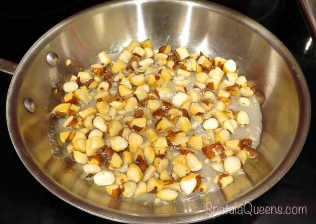 Nuts and sugar in saucepan in Brazil Nut Cheesecake Recipe