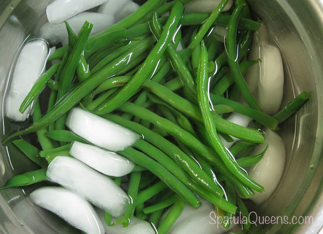 Plunge blanched beans into iced water to stop the cooking